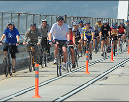 Governor Markell biking across bridge image